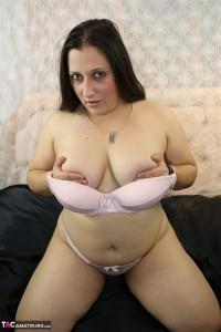 Slut in pink lingerie fucks herself